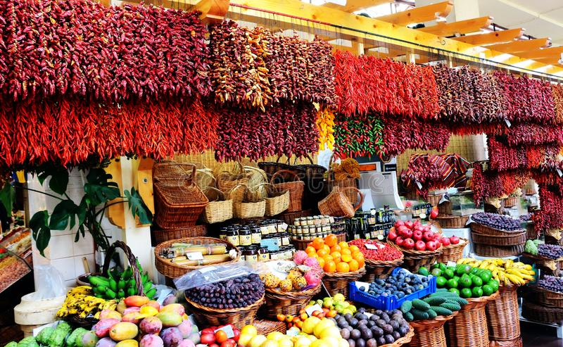 A bazaar with dried peppers and fruit. stock photography