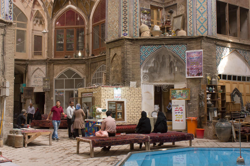 Bazaar of Kashan, Central Iran. Kashan Bazaar is a very old bazaar in Iran. It features beautiful traditional persian architecture. This photo shows one big hall royalty free stock photo