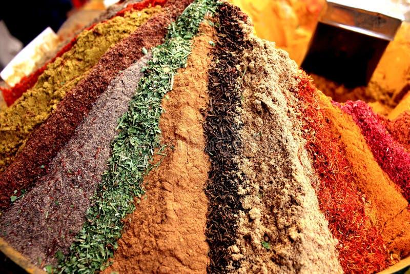 Bazaar in Mashad, Iran. Spice pyramid in bazaar in Mashad, Iran royalty free stock photography