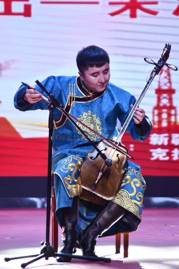 Bazhou, Xinjiang, China: Las empresas mezcladas de la propiedad realizan la actividad de 'tomar la cultura de los pueblos en hoga imagen de archivo