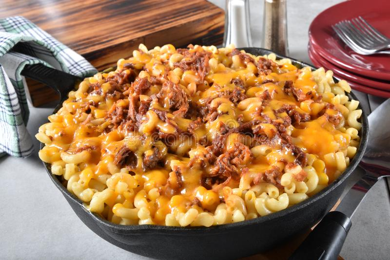 BBQ Beef Macaroni and Cheese. Served in a cast iron skillet royalty free stock image