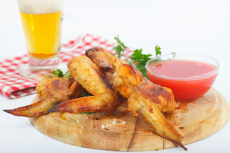 Bbq chicken wings with red sauce and beer stock photo