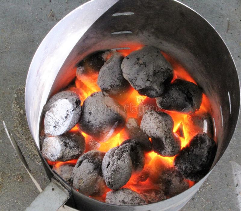 BBQ Chimney with Glowing Coals stock photo