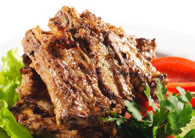 bbq dishes горячее мясо стоковое фото
