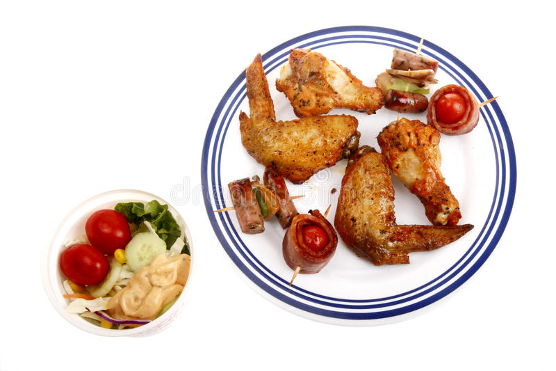 BBQ fast food. With vegetable salad on white stock image
