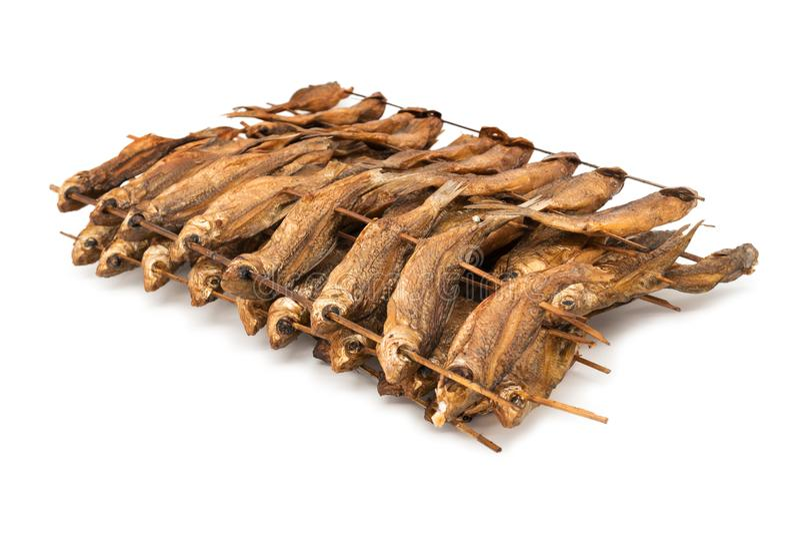 BBQ Fish on sticks stock images