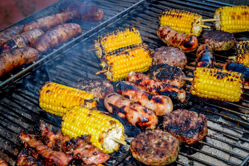 BBQ Food. Various BBQ food items including burgers, sausages and corn on the cobs royalty free stock photos