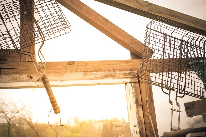 BBQ grill baskets hanging in greenhouse. Lifestyle and leisure c stock photos