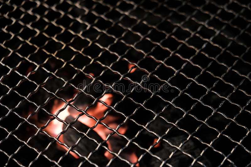 BBQ grill with hot charcoal below royalty free stock image