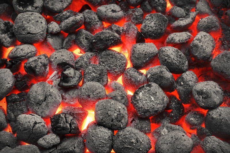 BBQ Grill Pit With Glowing Hot Charcoal Briquettes, Closeup. BBQ Grill Pit With Glowing And Flaming Hot Charcoal Briquettes, Food Background Or Texture, Close-Up stock photo