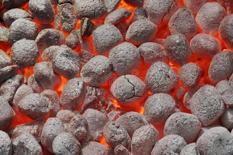 BBQ Grill Pit With Glowing Hot Charcoal Briquettes, Closeup. BBQ Grill Pit With Glowing And Flaming Hot Charcoal Briquettes, Food Background Or Texture, Close-Up stock photos