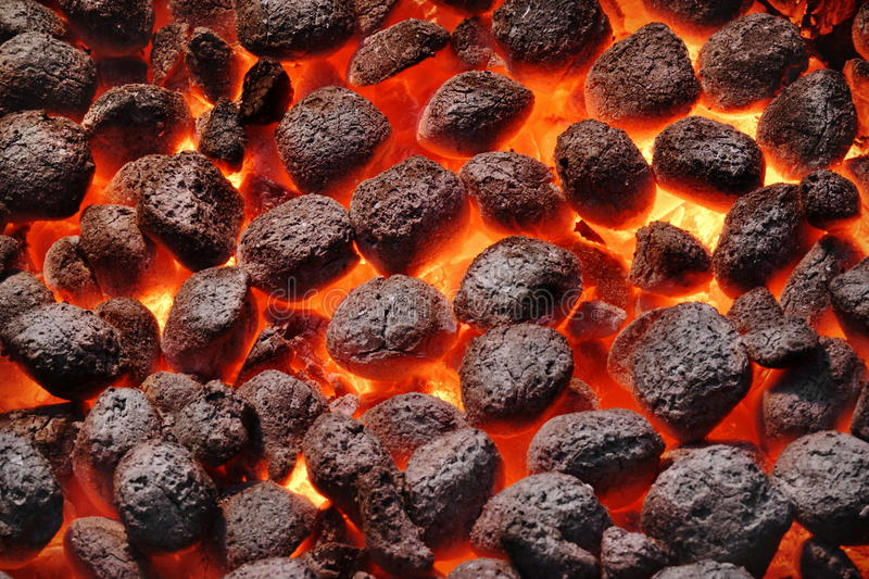 BBQ Grill Pit With Glowing Hot Charcoal Briquettes, Closeup. BBQ Grill Pit With Glowing And Flaming Hot Charcoal Briquettes, Food Background Or Texture, Close-Up stock image