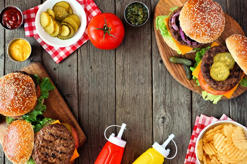 BBQ hamburger frame, above view over a dark wood background stock photo