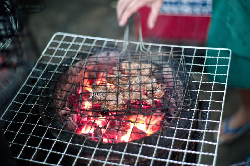 BBQ meat by the charcoal grilled with the flame of fire. On the traditional clay stove stock images