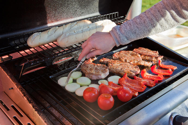 BBQ. Meat and vegetable BBQ at grill stock image