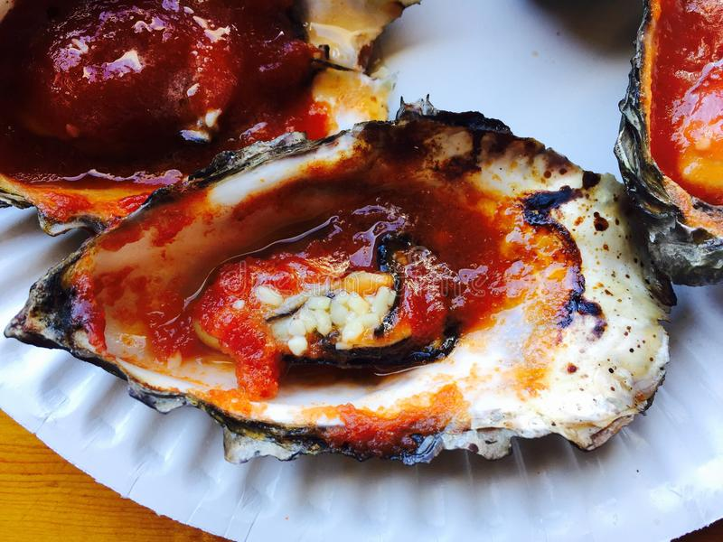 BBQ Oyster. Open fire BBQ oyster fresh from the bay stock photography