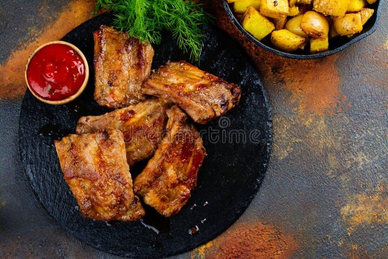 BBQ pork ribs. And golden potato wedges. Copy space stock photos
