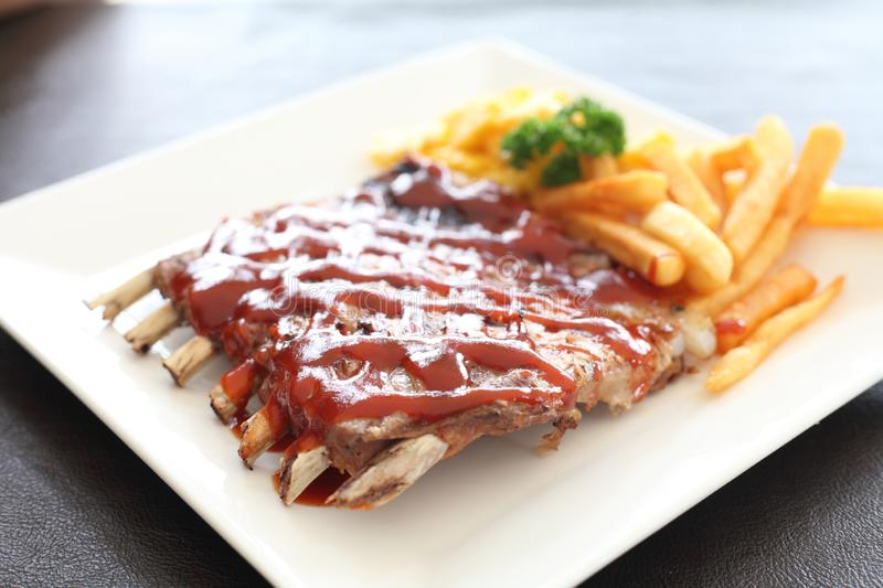 BBQ ribs. On a plate in close up stock photos