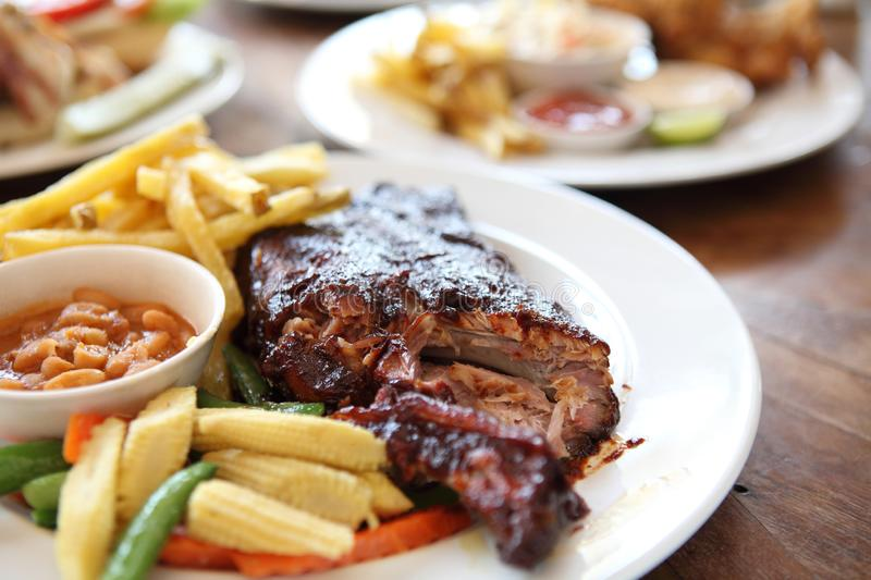 BBQ ribs. On a plate in close up royalty free stock photography