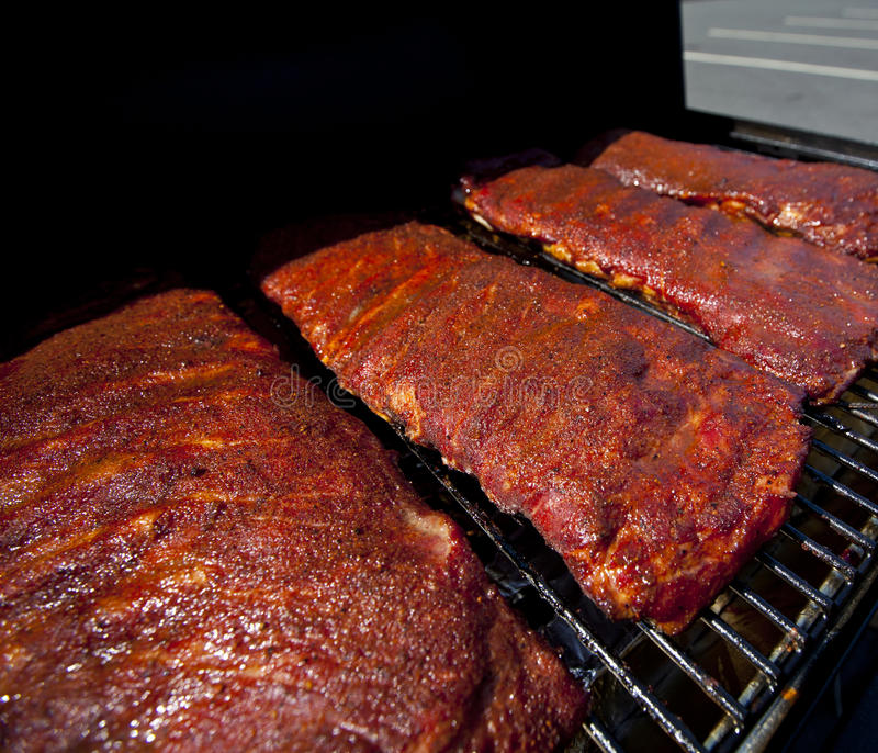 BBQ ribs. Cooking on a hot grill royalty free stock photos