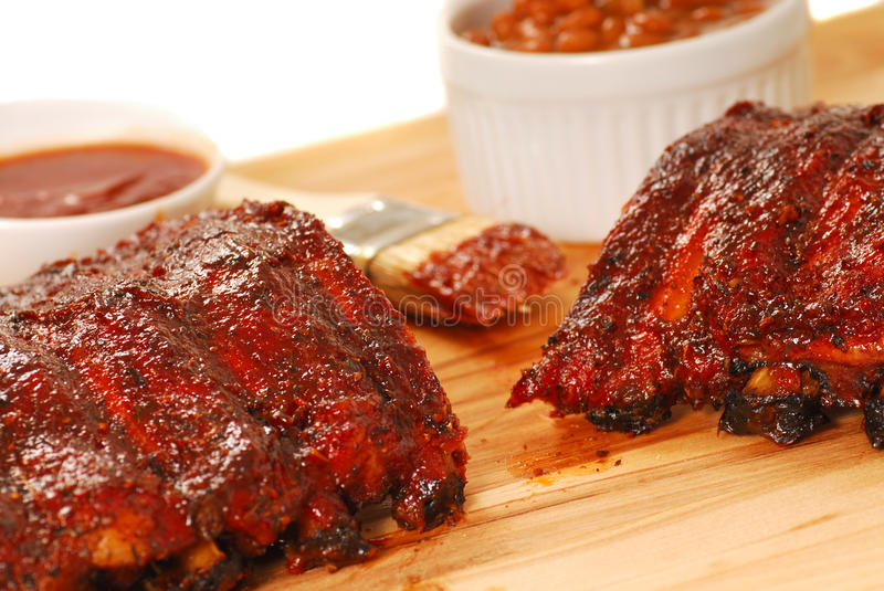 BBQ Ribs with beans and dipping sauce royalty free stock photo