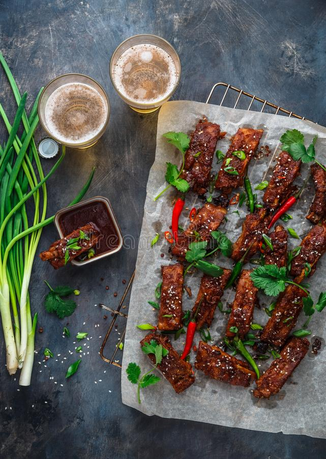 BBQ Ribs with beer, onion and chili. BBQ Ribs with beer, onion and chili stock photo