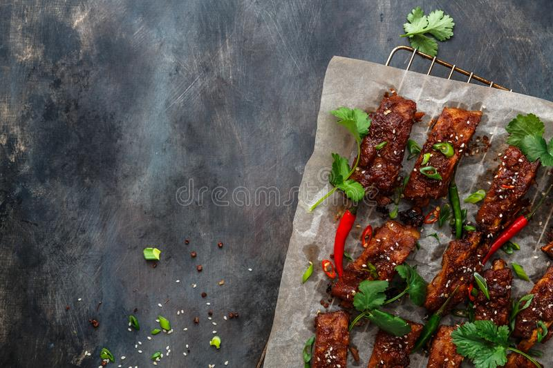 BBQ Ribs with beer, onion and chili, copy space.  royalty free stock image