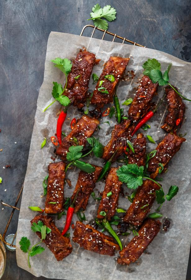 BBQ Ribs with beer, onion and chili, copy space.  stock images