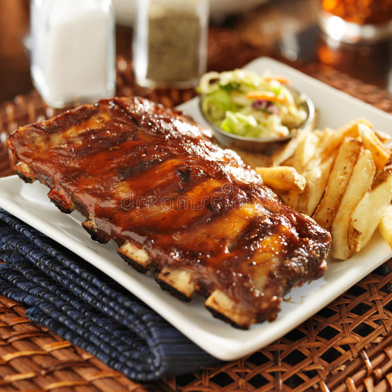 Bbq ribs with cole slaw. And french fries stock images