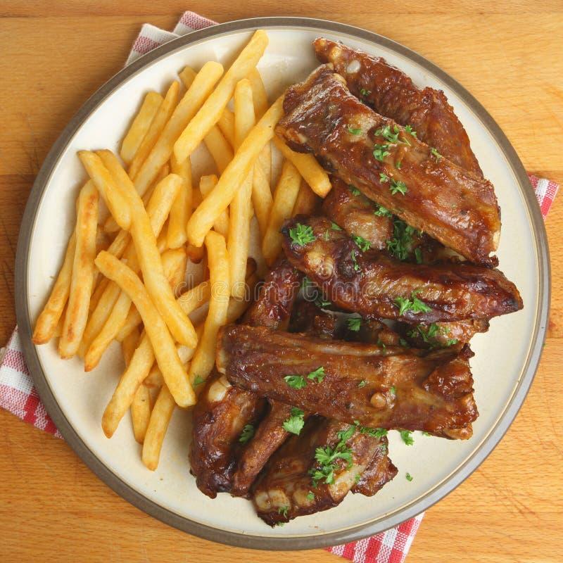 BBQ Ribs & Fries. Marinated bbq pork ribs and fries royalty free stock photo