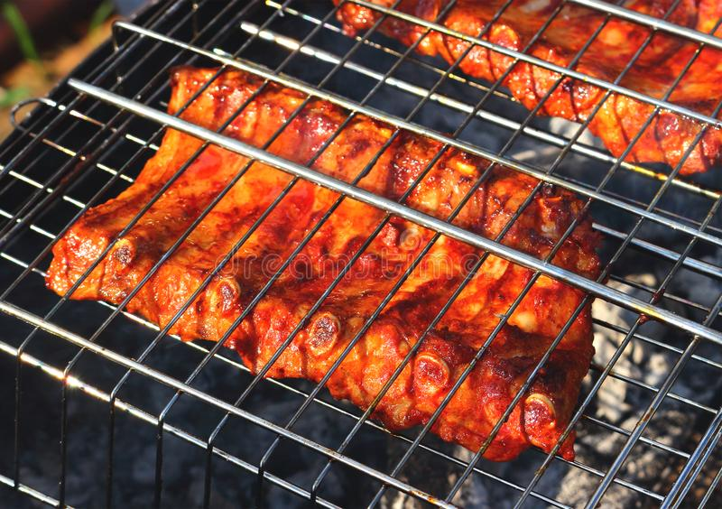 BBQ ribs on grill royalty free stock photos