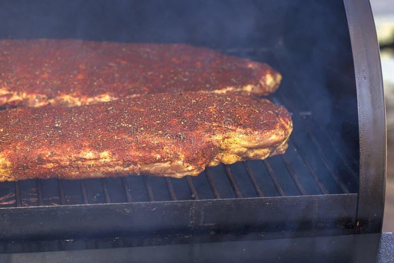 BBQ Ribs. On the Smoker royalty free stock photo