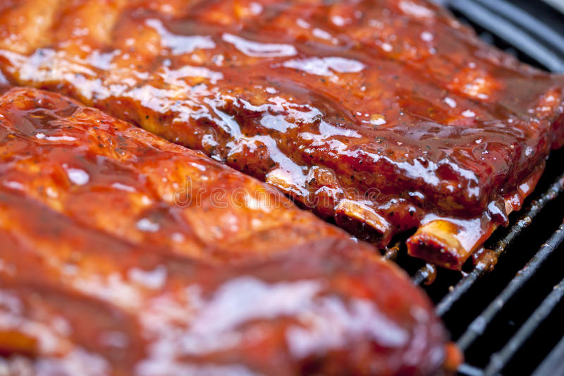 BBQ Ribs. St Louis style BBQ ribs glazed in sauce royalty free stock photography