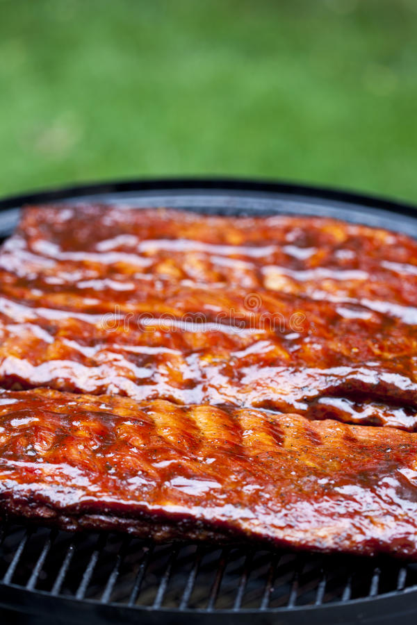 BBQ Ribs. St Louis style BBQ ribs glazed in sauce stock image