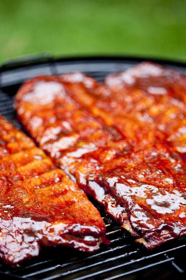 BBQ Ribs. St Louis style BBQ ribs glazed in sauce stock photo