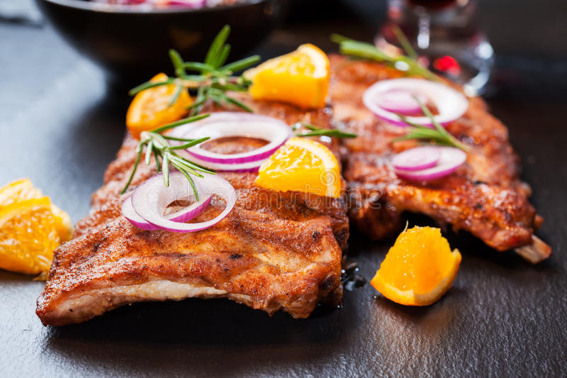 BBQ spare ribs with orange. BBQ spare ribs marinated in orange sauce with herbs and wine stock images