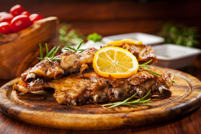 BBQ spare ribs. With orange and dips stock photos