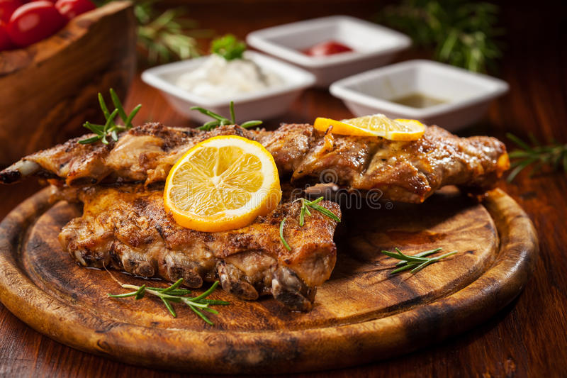BBQ spare ribs. With orange and dips royalty free stock images