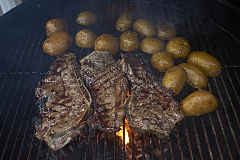 BBQ steak and  potatoes stock photos