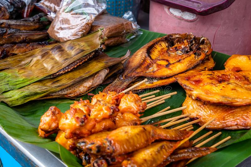 BBQ Street food grilled right at the side of the road fresh. Many Thai people eat as a cheap snack between meals. Pattaya, Thailand - August 1, 2019: BBQ Street stock photos