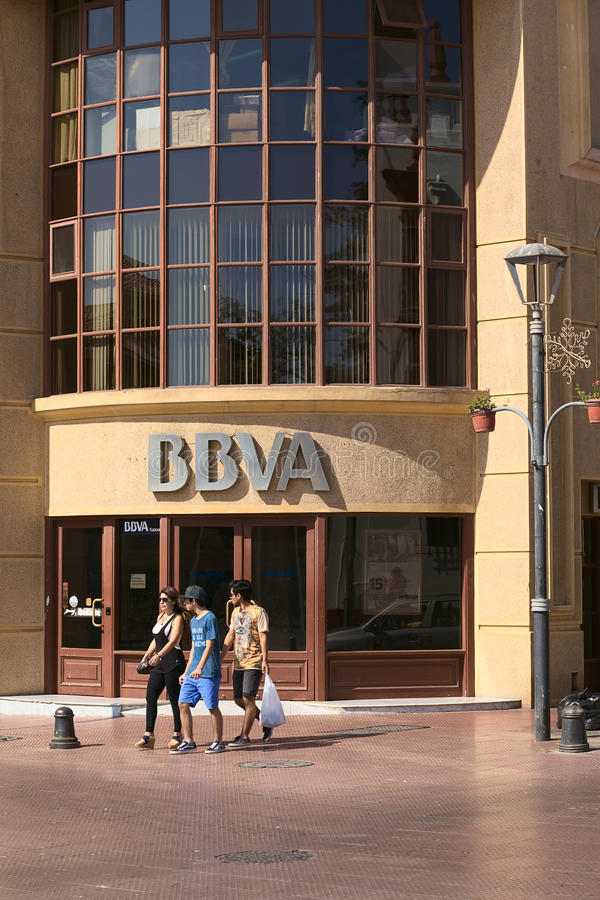 BBVA Bank in La Serena, Chile. LA SERENA, CHILE - FEBRUARY 19, 2015: Unidentified people walking in front of a branch of the multinational Spanish banking group stock photo