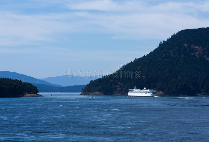 BC Ferry. A BC Ferry enters a channel way amid the Gulf Islands in route to Swartz Bay on Vancouver Island royalty free stock images