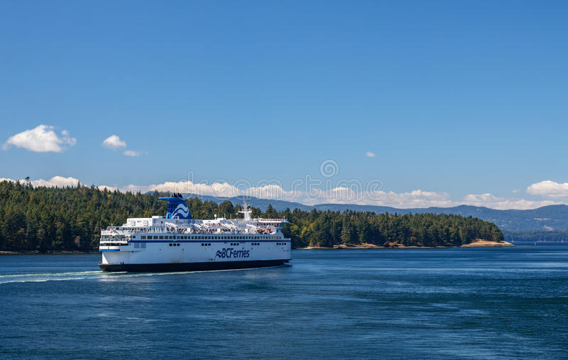 BC Ferry. GULF ISLANDS, BRITISH COLUMBIA, CANADA – AUGUST 04, 2016: BC Ferry passes Gulf Islands. BC Ferries provides an essential link from mainland royalty free stock photo