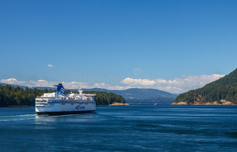 BC Ferry. GULF ISLANDS, BRITISH COLUMBIA, CANADA – AUGUST 04, 2016: BC Ferry passes Gulf Islands. BC Ferries provides an essential link from mainland royalty free stock images