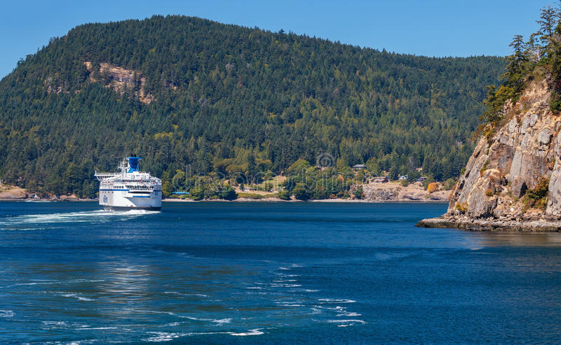 BC Ferry. GULF ISLANDS, BRITISH COLUMBIA, CANADA – AUGUST 04, 2016: BC Ferry passes Gulf Islands. BC Ferries provides an essential link from mainland royalty free stock image