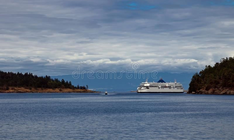 BC Ferry in Strait of Georgia. The ferry makes a regular flight from Vancouver to Nanaimo, windy day, stormy sky, stormy sea, blue water with a green tint royalty free stock image