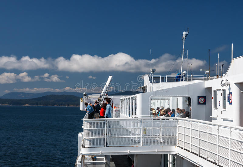 BC Ferry. TSAWWASSEN, DELTA, BRITISH COLUMBIA – AUGUST 04, 2016: Passengers on the sun deck of the BC Ferry. BC Ferries provides an essential link from stock photos