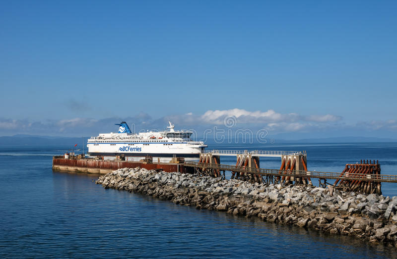 BC Ferry. Tsawwassen, Municipality of Delta, British Columbia, Canada – August 04, 2016: BC Ferry arrives to ferry terminal at Tsawwassen, August 04, 2016 royalty free stock photo