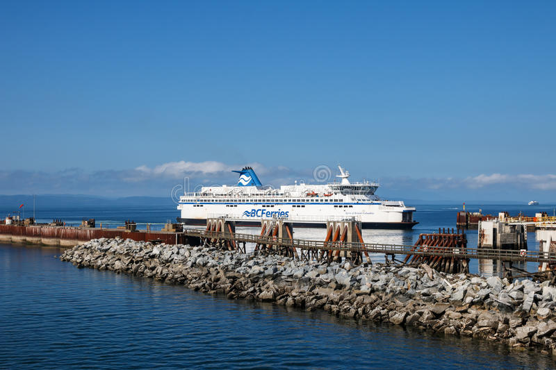 BC Ferry. Tsawwassen, Municipality of Delta, British Columbia, Canada – August 04, 2016: BC Ferry arrives to ferry terminal at Tsawwassen, August 04, 2016 stock photo