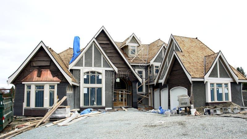 bc home hus för konstruktion arkivfoto